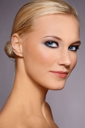 smoky eyes: Portrait of beautiful stylish smiling blonde girl with trendy make-up