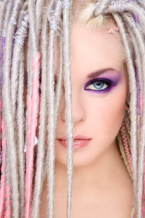 Close-up portrait of young beautiful girl with stylish make-up and dreads