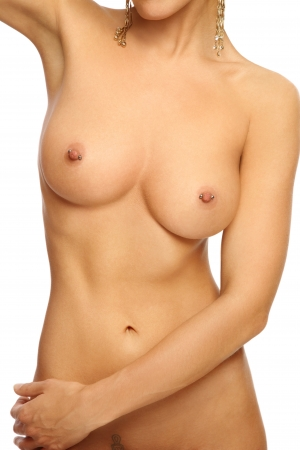 Perfect athletic slim sexy naked woman torso with pierced nipples  photo