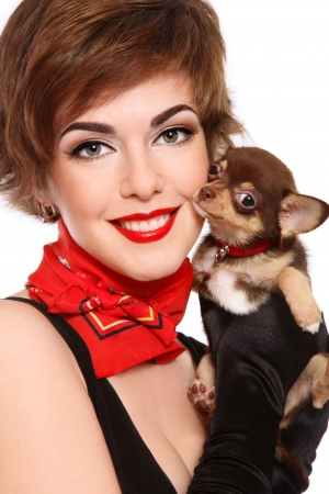 Portrait of young beautiful smiling woman with stylish makeup holding cute puppy chihuahua photo