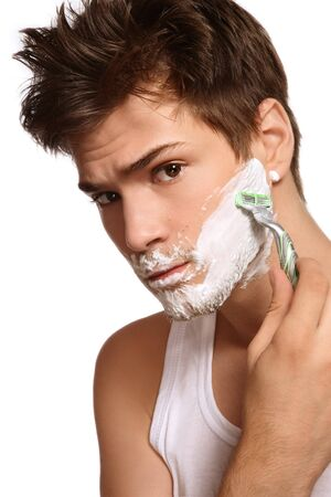 Portrait of young beautiful sexy man shaving photo