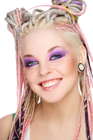 Portrait of young beautiful happy laughing girl with stylish make-up and dreads