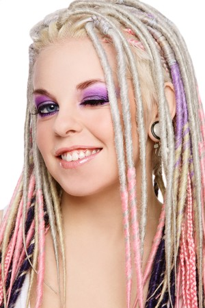 Portrait of young beautiful happy smiling girl with stylish make-up and dreads