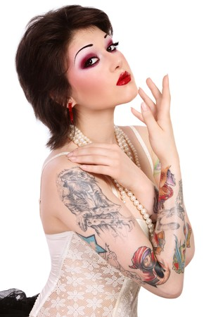 Beautiful slim young tattooed woman in ballet skirt and vintage corset on white background Stock Photo - 7249713