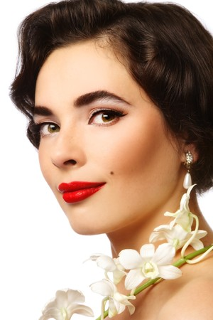 Close-up portrait of beautiful young woman with classical glamorous make-up and white orchid  photo