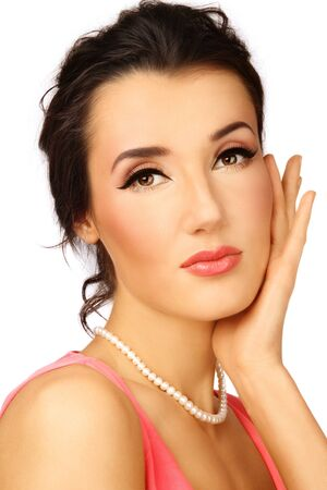 Portrait of young beautiful woman with stylish coral make-up touching her face Stock Photo - 7308249