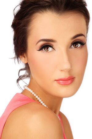 entice: Portrait of young beautiful woman with stylish coral make-up