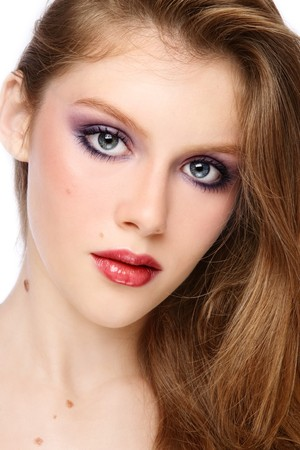 Portrait of young beautiful girl with long hair and stylish make-up photo