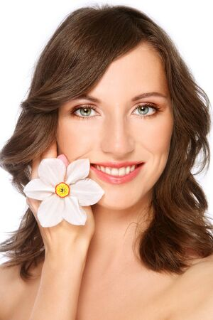 radicals: Beautiful happy young healthy woman with flower in hand touching her face, on white background Stock Photo