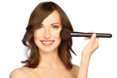 Beautiful happy smiling young woman applying make-up with big brush, on white background Stock Photo - 7367214