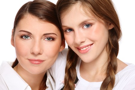 mother and daughter: Close-up portrait of attractive happy mother and smiling teen daughter, on white background Stock Photo