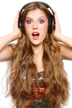 Beautiful stylish excited happy teen girl in headphones listening music  photo