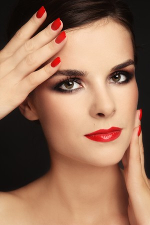 Close-up portrait of beautiful elegant brunette with trendy make-up and red manicure Stock Photo - 7396721