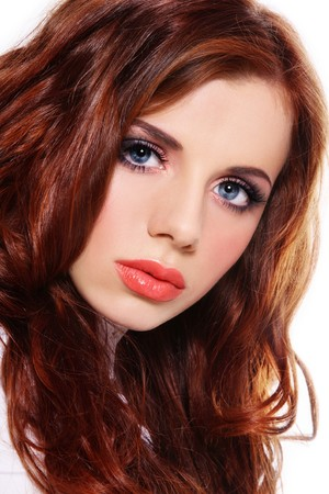Portrait of young fresh beautiful girl with red curly hair and stylish make-up photo