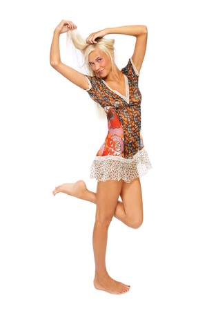 Young beautiful slim tanned barefoot blond girl in sexy dress over white background Stock Photo - 7497409