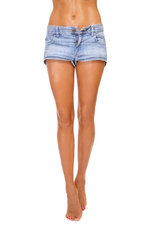 Long beautiful tanned slim legs of young sexy woman in blue denim shorts, on white background Stock Photo - 7497411