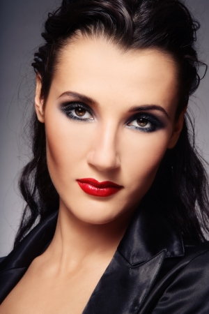 Close-up portrait of beautiful elegant brunette with trendy make-up Stock Photo - 7501276
