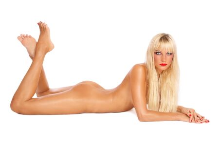 Beautiful slim tanned sexy naked blond girl laying on white background Stock Photo - 7716177