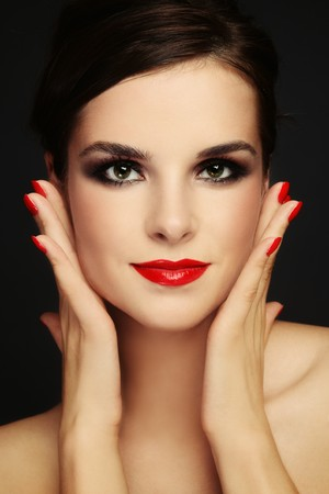Portrait of young beautiful woman with stylish make-up photo