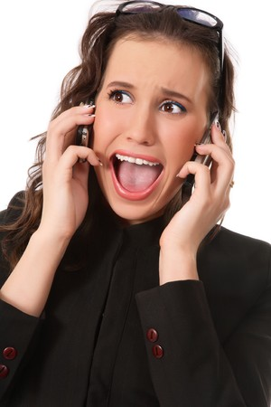 Emotional portrait of young business woman with two mobile phones and crazy expression photo