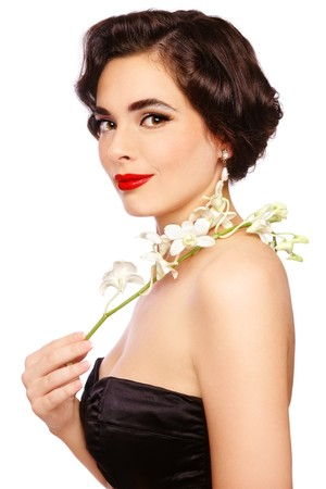 Portrait of young beautiful sexy woman in vintage bra with orchid, on white background photo