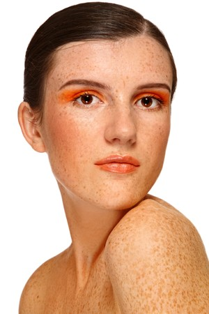 free radicals: Portrait of young attractive girl with freckles and orange make-up on white background
