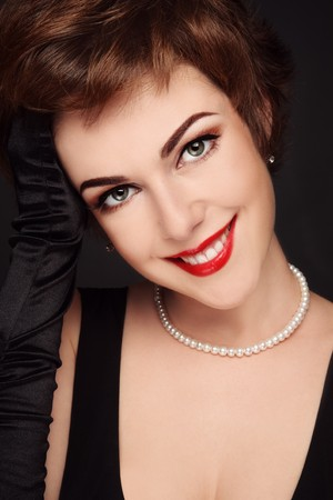 Portrait of young beautiful smiling woman with glamorous make-up Stock Photo - 7817629