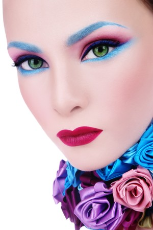 cosmetologies: Close-up glamorous portrait of young beautiful woman with fancy blue make-up and collar of silk roses