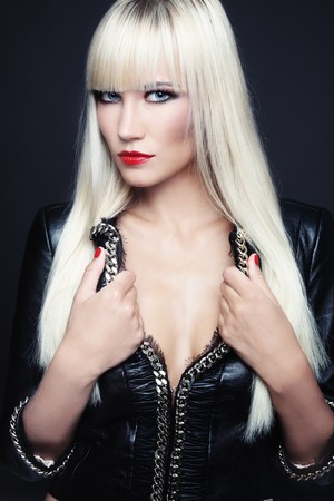 Beautiful slim sexy blond girl in leather jacket Stock Photo - 7956521