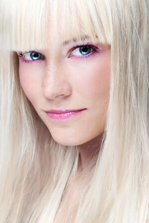 blonde close up: Close-up portrait of young beautiful platinum blonde girl with stylish make-up