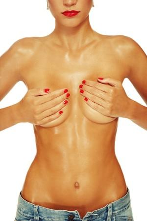 tieten: Vette torso van slanke atletische gebruinde sexy vrouw in denim shorts  Stockfoto
