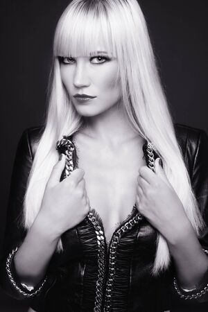 Duotone shot of beautiful slim sexy blond girl in leather jacket Stock Photo - 7956518
