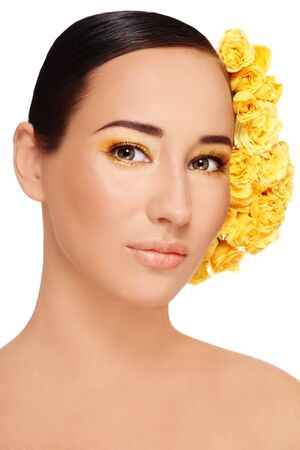 Portrait of young beautiful woman with stylish make-up and bright yellow roses in hair Stock Photo - 7956507