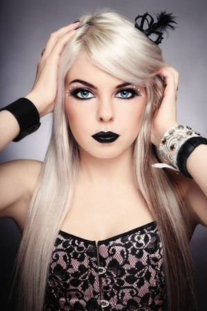 glamourous: Beautiful young sexy blond girl with stylish black make-up and fancy accessories