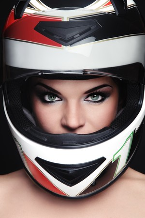 Portrait of beautiful woman with stylish makeup in biker helmet photo