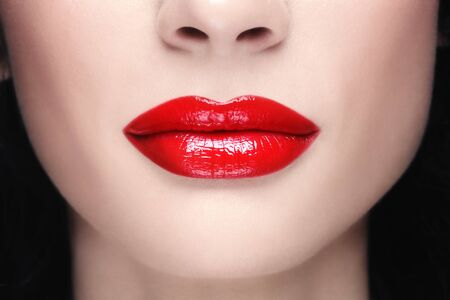 Close-up shot of woman lips with glossy red lipstick Stock Photo - 8086068