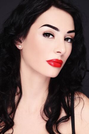Portrait of young beautiful sexy brunette with red lips photo