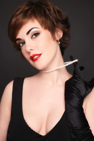 Portrait of young attractive glamorous woman with pearly necklace Stock Photo - 8086104
