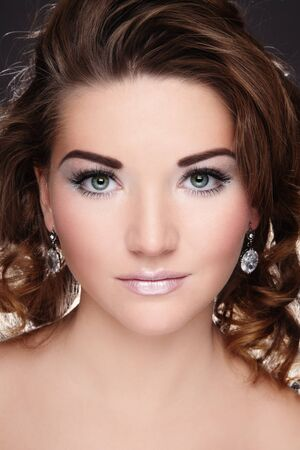 permanent: Beautiful young girl with glowing white make-up and curly hairstyle