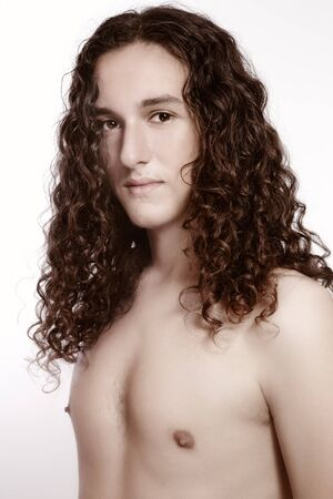 Portrait of young handsome man with beautiful long curly hair Stock Photo - 8247364