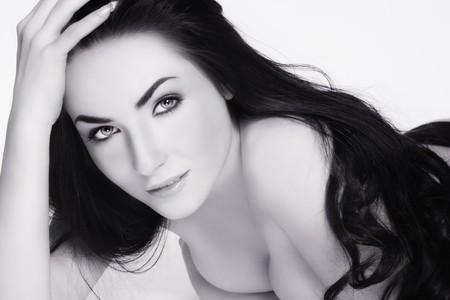 Duotone shot of beautiful woman with long dark hair photo