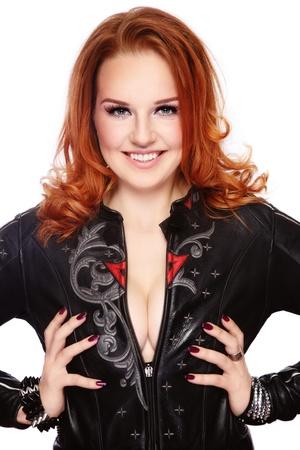 biker: Beautiful sexy redhead woman in black leather biker jacket on white background Stock Photo