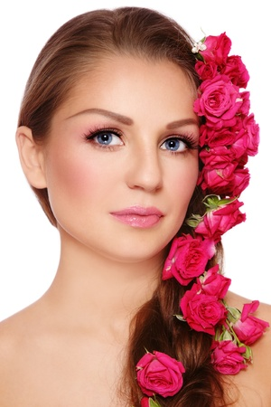 Portrait of young beautiful woman with rose in hair, on white background Stock Photo - 8417004