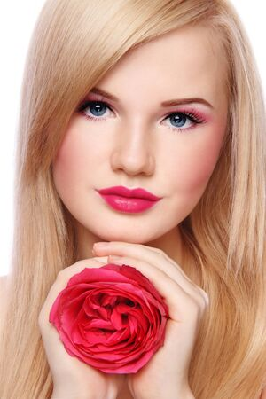 glamorous: Close-up portrait of young beautiful blond girl with pink rose in hands