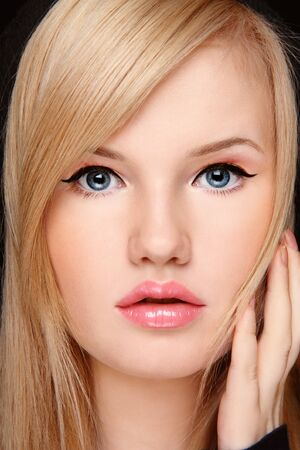 scared face: Close-up portrait of young blond girl with surprised or scared expression Stock Photo