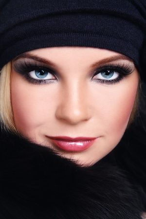 Close-up portrait of young beautiful woman with smoky eyes and huge fake eyelashes