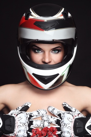 motorcyclist: Beautiful sexy woman with stylish makeup in biker helmet and gloves Stock Photo