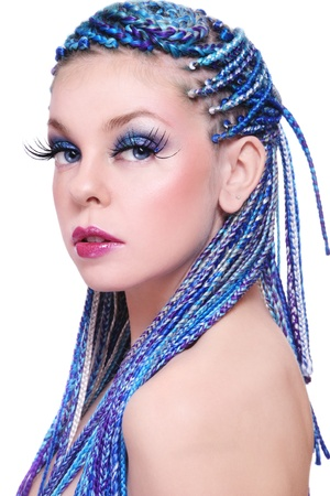 dreads: Portrait of young beautiful girl with fancy blue hairstyle and extra long fake eyelashes, on white background Stock Photo