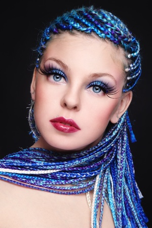 dreadlock: Portrait of young beautiful girl with fancy blue hairstyle and extra long fake eyelashes
