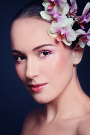 Young beautiful woman with orchid in her hair Stock Photo - 9026562